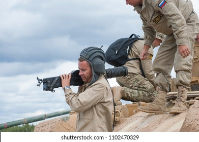 """MILITARY GROUND ALABINO, MOSCOW OBLAST, RUSSIA - Aug 24, 2017: Russian tankers hold AGS """"Flame"""" grenade launcher near combat vehicle supporting tanks BMPT Terminator, international forum ARMY-2017"""