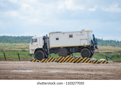 MILITARY GROUND ALABINO, MOSCOW OBLAST, RUSSIA - Aug 24, 2017: Arctic all-terrain vehicle KAMAZ (rescue vehicle) is moving through an obstacle, international military-technical forum ARMY-2017