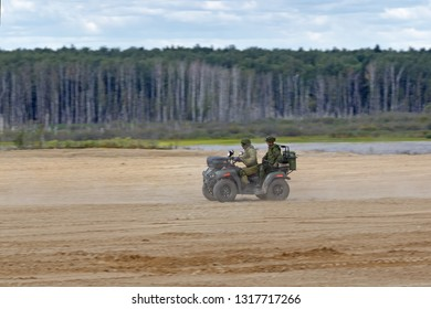 MILITARY GROUND ALABINO, MOSCOW OBLAST, RUSSIA - AUG 22, 2018: Soldiers on a Quad bike in demonstrations at the International military-technical forum ARMY-2018