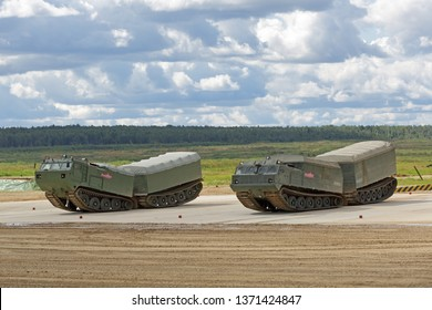 MILITARY GROUND ALABINO, MOSCOW OBLAST, RUSSIA - AUG 22, 2018: The two-tier tracked all-terrain amphibian vehicles DT-10P and DT-30P at the International military-technical forum ARMY-2018
