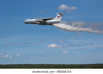 MILITARY GROUND ALABINO, MOSCOW OBLAST, RUSSIA - JUN 18, 2015: The flying aerial firefighting Ilyushin Il-76 pour water at the International military-technical forum ARMY-2015