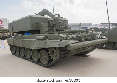 MILITARY GROUND ALABINO, MOSCOW OBLAST, RUSSIA - Aug 22, 2017: Ammunition resupply vehicle TZM-T heavy flamethrower system TOS-1A on International military-technical forum Army-2017, a left-back