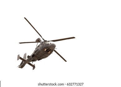 Military helicopter in flight, isolated on white