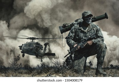 Military helicopter and forces between fire and dust in the battlefield