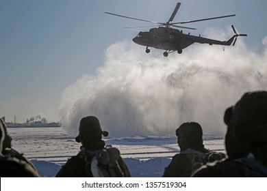 Military helicopter landing in winter