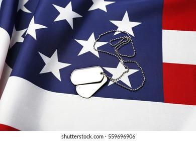 Military ID tags on USA flag background