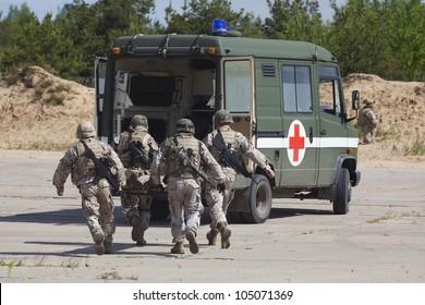military intervention. soldier in action. War concept. War victim, injured soldier being rescued.