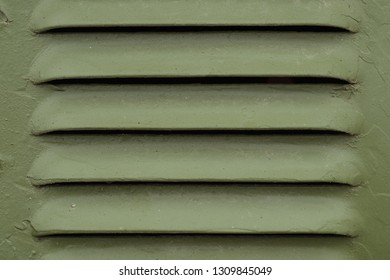 military khaki background. military background ventilation. Khaki color ventilation grille on retro military equipment. army vents.
