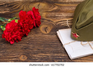 Military letters under the cap and three carnations in honor of May 9