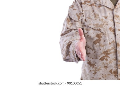 Military Man in Desert Fatigues Offers Handshake