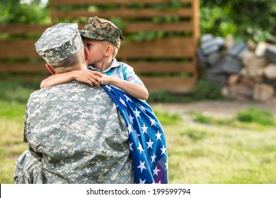 Military man father hugs son. Portrait of happy american family. focus on father back