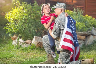 Military man father hugs son. Portrait of happy american family