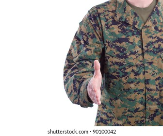 Military Man in Green Fatigues Offers Handshake