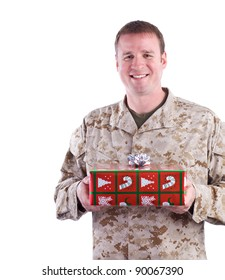 Military Man Holding a Christmas Present