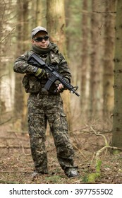 Military man with Rifle M16 outdoor forest