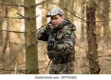 Military man with Rifle M16 outdoor forest, He said on the radio