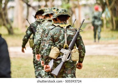 Military man with Rifle M16 outdoor forest, without a face  M16 military rifles.