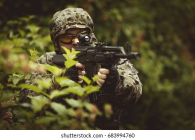Military man with submachine gun