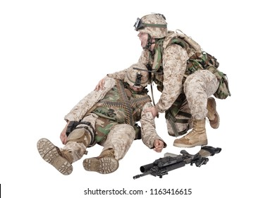 Military medic, commando shaking for shoulders, trying bring to consciousness, checking condition of unconscious, wounded soldier or comrade, isolated on white. Injured, dying infantryman rescue