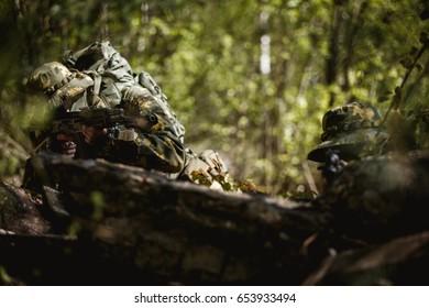 Military men with submachine gun