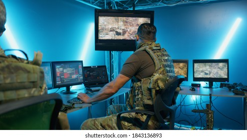 Military men working on computer systems while hiding in secret base of intelligence