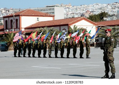 Military officers hold flags during a Chief of Staff Handover-Takeover Ceremony of  NATO Rapid Deployable Corps in Thessaloniki, Greece on Jan. 12, 2012.
