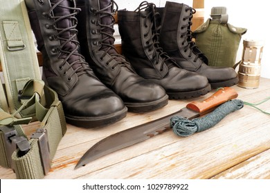 Military pack for soldier,army water canteen ,rope,light,Military combat boots, combat knife ,hat on white wooden background,top view for copy space
