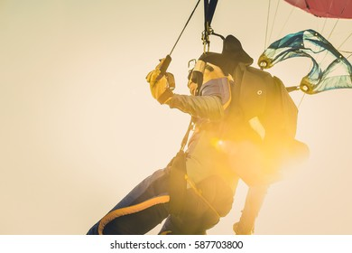 Military parachuting, skydiving sports in Thailand  ,  Kite surfer sailing in the sea at sunset ocean