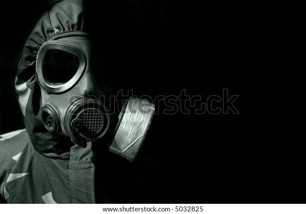 military person wearing a gasmask and protective clothing