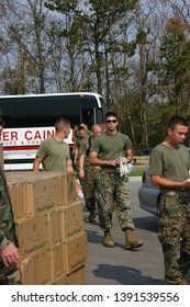 Military personnel arrive to begin transporting supplies to Hurricane Katrina victims.  Taken in Biloxi, MS on. August 5, 2005.