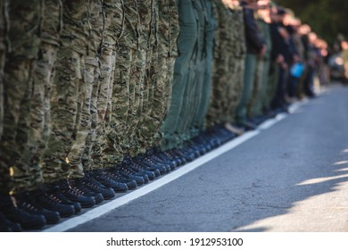 Military personnel lined up at a military show