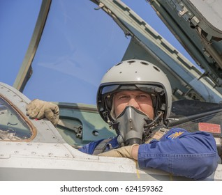 Military pilot in the cockpit of a jet aircraft.