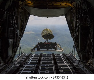 Military plane performs an airdrop