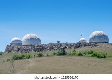Military radar station on top of the mountain. Russia, Republic of Crimea. 06/13/2018: Military radar station on the top of Perepelina Mountain, Ai-Petri plateau