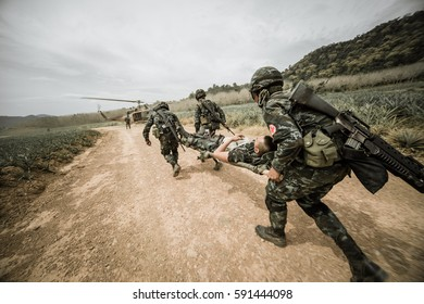 Military rescue czech army helicopter ,  United States paratroopers airborne infantrymen in the desert rescuing their brother