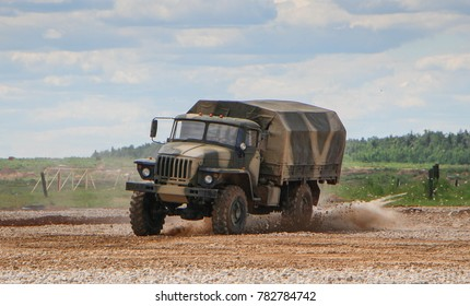 Military russian green army vehicle in motion