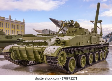 Military russian tank and aircrafts in the background