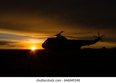 Military Sea King helicopter silhouette  on a beautiful sunrise