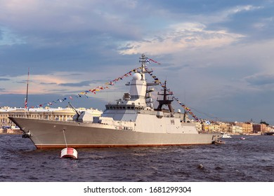 military ship on Neva river in St. Petersburg against the blue sky and the city