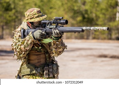 Military sniper with gun