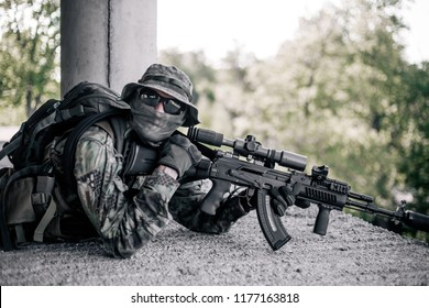 Military sniper took a firing position in the destroyed, abandoned building of the city. Urban warfare, urban warfare