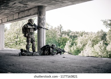 Military snipers took a firing position in the destroyed, abandoned building of the city. Urban warfare, urban warfare