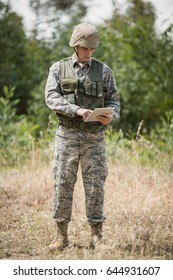 Military soldier using digital tablet in boot camp