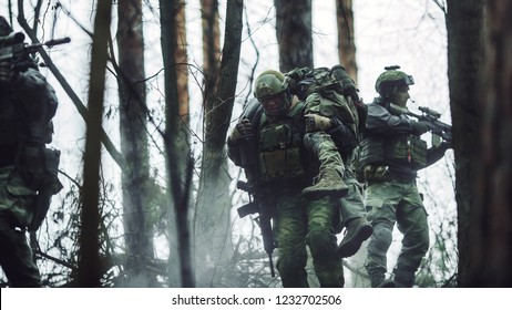 military soldiers carrying teammate out of the mission
