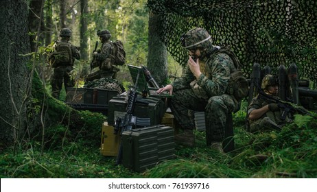 Military Staging Area, Chief Engineer Uses Radio and Army Grade Laptop. Forest Operation/ Mission in Progress.