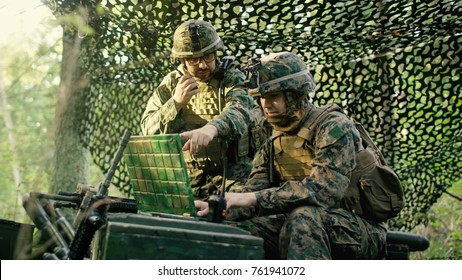 Military Staging Base, Chief Engineer Uses Radio and Army Grade Laptop. Forest Operation/ Mission in Progress.
