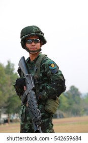 Military, stood holding rifle,