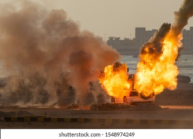 Military strike or bomb in war on a car causes fire ball and explosion in the town in chaos. Military war concept. Strength, power, force, fire, explosion.