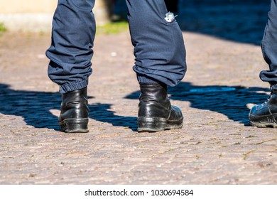 Military style black boots in the streets of Germany