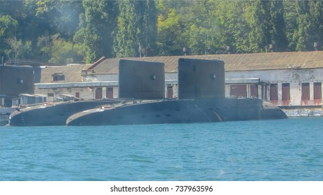 Military submarines in the sea The top of the two submarines Seaport military base Teachings maneuvers Underwater fleet